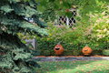 Grinning jack o lanterns on stone wall two set beneath windows Stock Images