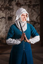 Grinning nun in middle ages dress holding a dagger Stock Image