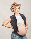 Grinning pregnant hillbilly young single female with smile Royalty Free Stock Images