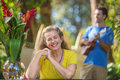 Grinning woman listening to musician adult female in hawaii Royalty Free Stock Images