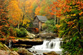 Grist mill surrounded by fall leaves Royalty Free Stock Photo