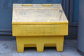 Grit salt yellow plastic box with ready for winter Royalty Free Stock Image
