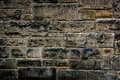 Gritty brick stone wall old background texture Stock Photography