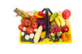 Grocery basket a yellow shopping full of fruits and vegetables overhead view on a white background Stock Photo