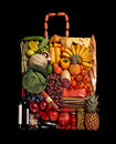 Grocery handbag studio photography of designer made from different fruits and vegetables on black background Stock Photography