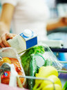 Grocery items being collected by a woman Stock Photography