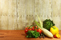 Grocery produce items on a wooden plank bunch of Royalty Free Stock Photo