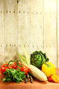 Grocery produce items on a wooden plank bunch of Stock Images