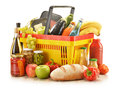 Grocery products in shopping basket Stock Photography