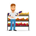 Grocery salesperson with vegetables.