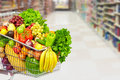 Grocery shopping cart with vegetables. Royalty Free Stock Photo