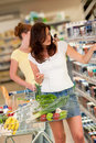 Grocery shopping store - Beautiful woman Stock Images