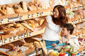 Grocery shopping store Brown hair woman with child Stock Image