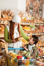 Grocery shopping store - Red hair woman with boy Royalty Free Stock Photography