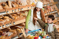 Grocery shopping store - Red hair woman with boy Royalty Free Stock Photo