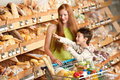 Grocery shopping store - Red hair woman and child Royalty Free Stock Images