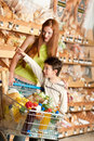Grocery shopping store - Red hair woman and child Royalty Free Stock Photo