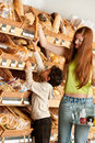 Grocery shopping store - Red hair woman with child Royalty Free Stock Photo