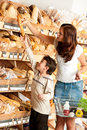 Grocery shopping store - Woman with little boy Royalty Free Stock Photo