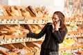 Grocery store: Business woman holding mobile Royalty Free Stock Photo
