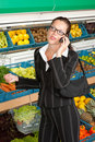 Grocery store - Business woman with mobile phone Royalty Free Stock Photo