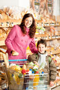 Grocery store - Happy woman and child Stock Image