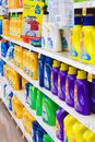 Grocery store laundry detergent purex arm and hammer clorox and other famous brands of line a shelf Stock Photos