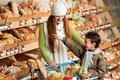 Grocery store - Long red hair woman with child Royalty Free Stock Photo