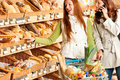 Grocery store: Red hair woman and brunette Stock Image