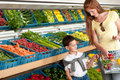 Grocery store - Red hair woman with child Royalty Free Stock Photo