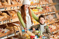 Grocery store - Red hair woman with little boy Royalty Free Stock Photo