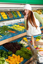 Grocery store - Red hair woman in winter outfit Royalty Free Stock Photo
