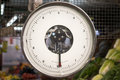 Grocery store scale kilograms units isolated with fruits and vegetables background Stock Photo