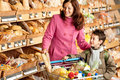 Grocery store - Smiling woman with child Royalty Free Stock Photo