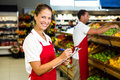 Grocery store staff with clipboard Royalty Free Stock Photo