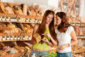 Grocery store: Two women choosing bread Royalty Free Stock Photography