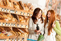 Grocery store: Two young women Royalty Free Stock Photos
