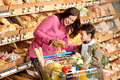 Grocery store - Woman with little boy Royalty Free Stock Photo