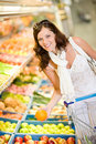Grocery store - woman shopping choose fruit Stock Photography
