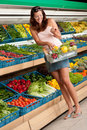 Grocery store: Woman in summer outfit Royalty Free Stock Photo