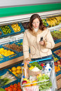 Grocery store - Woman in winter outfit Royalty Free Stock Photo