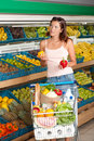 Grocery store - Young woman choosing pepper Royalty Free Stock Photo