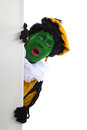 Groene zwarte piet black pete typical dutch character part of a traditional event celebrating the birthday of sinterklaas in Royalty Free Stock Photo