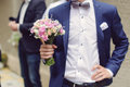 Groom with bouquet holding elegant wedding Stock Photography