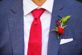 Groom boutineer detail a wearing a on his wedding day made from natural flowers and plants Royalty Free Stock Image