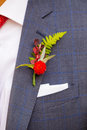 Groom boutineer detail a wearing a on his wedding day made from natural flowers and plants Stock Photography