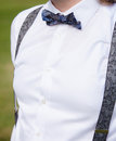 Groom with bow tie wearing white shirt and blue for special occasion Royalty Free Stock Photo