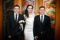 Groom with the bride and the brother of the groom of the twin Royalty Free Stock Photo