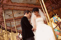 Groom and bride in a carousel Royalty Free Stock Photo