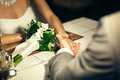 Groom and bride holding each others hand Royalty Free Stock Photo